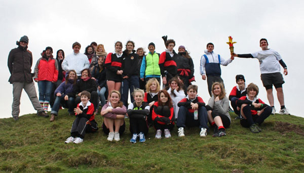 Olympic torch reaches the top of Maiden Castle