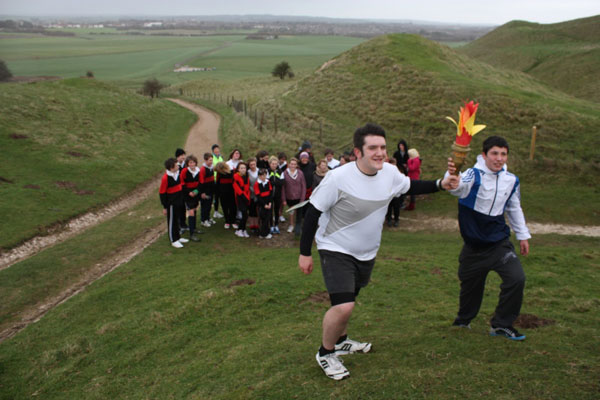 Olympic torch up Maiden Castle
